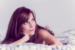 Beautiful young sexy latin woman lying in bed Royalty Free Stock Image
