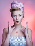 Beautiful young sexy pin-up girl with surprised expression Stock Images