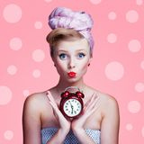 Beautiful young pin-up girl with surprised expression Royalty Free Stock Images