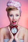 Beautiful young pin-up girl with surprised expression Stock Photography