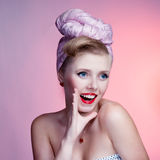 Beautiful young pin-up girl with surprised expression, on white background Royalty Free Stock Photos