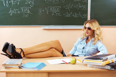 Beautiful young sexy teacher. Resting between the classes Stock Images