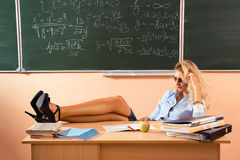 Beautiful young sexy teacher Stock Images