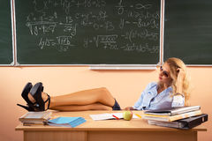 Beautiful young sexy teacher. Resting between the classes Royalty Free Stock Photography