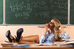 Beautiful young sexy teacher. Resting between the classes Royalty Free Stock Images