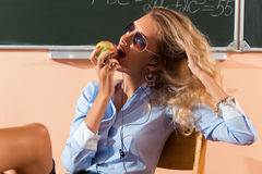Beautiful young sexy teacher. Resting between the classes Royalty Free Stock Photo