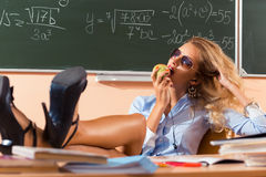 Beautiful young sexy teacher. Resting between the classes Royalty Free Stock Image