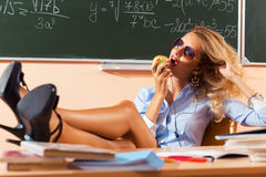 Beautiful young sexy teacher. Resting between the classes Royalty Free Stock Photos