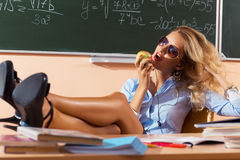 Beautiful young sexy teacher. Resting between the classes Stock Photos