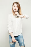 Beautiful Young Sexy Woman in Blue Jeans Posing Royalty Free Stock Image