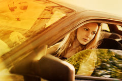 Beautiful young sexy woman in car Stock Photography