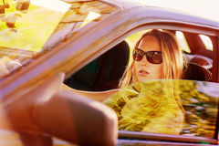 Beautiful young sexy woman in car Stock Photo