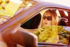 Beautiful young woman in car Stock Photo