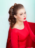 Beautiful young sexy woman with evening makeup and hair, with red lipstick Stock Photo