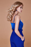 Beautiful young sexy woman with long wavy blond hair with bright Royalty Free Stock Images