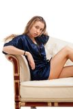 Beautiful young sexy woman sitting on chair Royalty Free Stock Photography