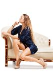 Beautiful young sexy woman sitting on chair Royalty Free Stock Image