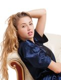 Beautiful young sexy woman sitting on chair Royalty Free Stock Images