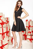 Beautiful young sexy woman thin slim figure evening makeup fashionable stylish coat, clothing collection, brunette, gifts boxes re. D silk bows holiday party Stock Images