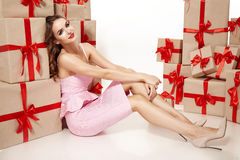 Beautiful young sexy woman thin slim figure evening makeup fashionable stylish coat, clothing collection, brunette, gifts boxes re Stock Photo