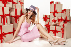 Beautiful young sexy woman thin slim figure evening makeup fashionable stylish coat, clothing collection, brunette, gifts boxes re. D silk bows holiday party Stock Photography