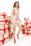 Beautiful young sexy woman thin slim figure evening makeup fashionable stylish dress, clothing collection, brunette, gifts boxes r Royalty Free Stock Photo