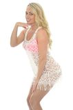 Beautiful Young Sexy Woman Wearing a Lacy See Through Mini Dress Royalty Free Stock Photography