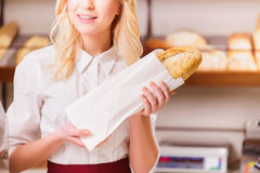 Beautiful young shop assistant in a bakery Stock Photos