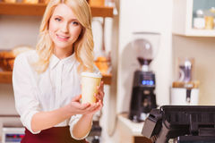 Beautiful young shop assistant in a bakery Royalty Free Stock Photos