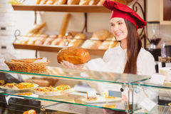 Beautiful young shop assistant in a bakery Royalty Free Stock Photo