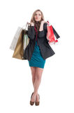 Beautiful and young shopping lady thinking Royalty Free Stock Photography