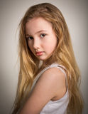 Beautiful young shy blond girl Stock Images