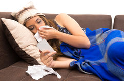 Beautiful young sick girl with a cold Stock Photography