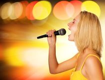 Beautiful young singer stock image