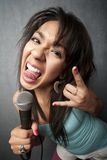 Beautiful Young Singer Sticking Out Her Tongue Royalty Free Stock Photo