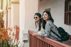 Sisters leaning on the guardrail for a break royalty free stock photo