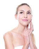 Beautiful young Skin care woman face. Isolated on white background. Skin care or spa concept Stock Photos
