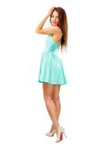 Beautiful young slim brunette woman wearing a blue dress isolate Stock Images