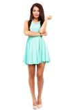 Beautiful young slim brunette woman wearing a blue dress isolate Stock Image
