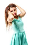 Beautiful young slim brunette woman wearing a blue dress isolate Royalty Free Stock Images