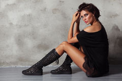 Beautiful slim tanned glamorous woman in black boots royalty free stock images