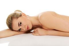 Beautiful young slim woman lying on belly. Stock Image