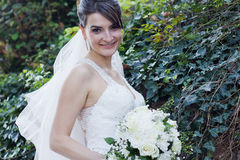 Beautiful Young Smiling Bride at Garden with Bouquet Stock Image