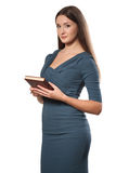 Beautiful young smiling businesswoman holding pen and notepad in Royalty Free Stock Photo