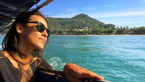 Beautiful Young Smiling Caucasian Woman Sails on a Wooden Thai Boat. Krabi, Thailand. stock video