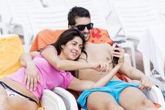 Beautiful young smiling  couple having fun making selfie Stock Photo