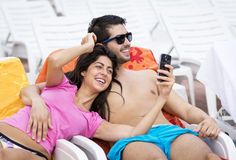 Beautiful young smiling  couple having fun making selfie Royalty Free Stock Photo