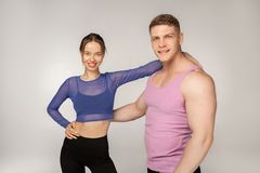 Beautiful young smiling couple in trendy sportswear stock photos