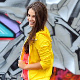 Beautiful young smiling girl in bright clothes Stock Photos