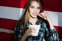 Beautiful young smiling girl eating french fries stock photos